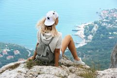 Young woman on top of mountain Royalty Free Stock Photos