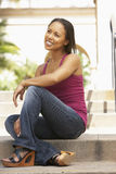 Young Woman Sitting On Steps Of Building Royalty Free Stock Images