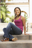 Young Woman Sitting On Steps Of Building Stock Image