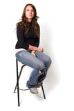 Young Woman Sitting on Stool Royalty Free Stock Photos