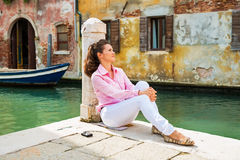 Young woman sitting on street in venice, italy Royalty Free Stock Photo