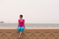 Young woman sitting after a successful training run Royalty Free Stock Photos