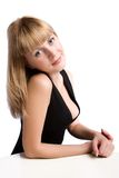 Young woman sitting at table Royalty Free Stock Photos