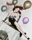 Young woman sitting on a table with balloons and sign Stock Photos