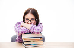 Young woman sitting at the table with books Stock Images