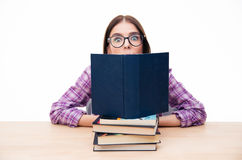 Young woman sitting on the table with books Stock Photography