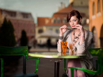 Attractive young woman with colorful beverage Stock Image