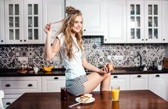 Woman Having Breakfast royalty free stock photos