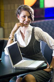 Young woman sitting at table with laptop computer Royalty Free Stock Images