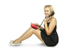Young woman sitting and talking on phone Stock Photography