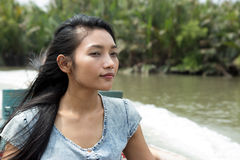 Young woman sitting in a taxi boat Royalty Free Stock Image