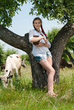 Young woman sitting tired near cows in countryside Stock Photo