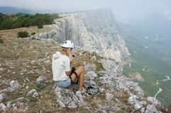 Young woman with smartphone on mountain Royalty Free Stock Images
