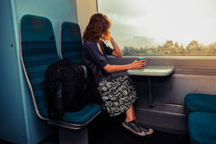 Young woman sitting on train Royalty Free Stock Images