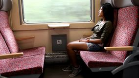 Young woman sitting in train. Young woman sitting in moving train stock video footage