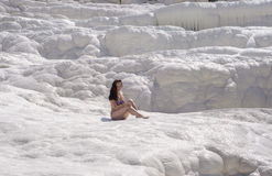 Young woman sitting on travertines in Pamukkale. Turkey Stock Photo