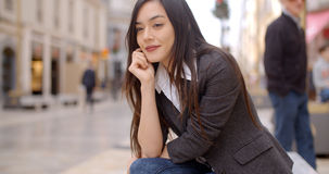 Young woman sitting waiting for someone Stock Image