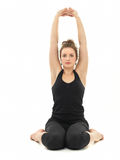 Young woman in sitting yoga posture Royalty Free Stock Images