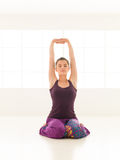 Young woman in sitting yoga posture Stock Photos