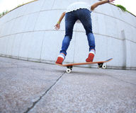 Young woman skateboard practice Stock Photo