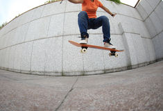 Young woman skateboarder practice Stock Photo