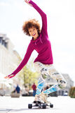 Young woman skateboarding Royalty Free Stock Photography