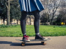 Young woman skateboarding in the park Royalty Free Stock Photo