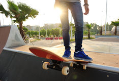 Young woman skateboarding at sunrise Royalty Free Stock Photo