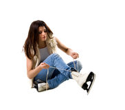 Young woman and skates Royalty Free Stock Image