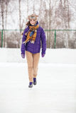 Young woman skating on ice with figure skates Royalty Free Stock Photos