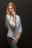 Young woman skeptic. Young woman in skeptical pose on black background Stock Image