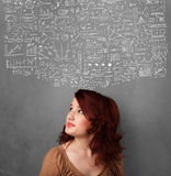 Young woman with sketched charts over her head. Thoughtful young woman with sketched charts over her head royalty free stock photos