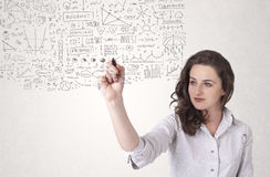 Young woman sketching and calculating thoughts Royalty Free Stock Photography