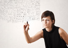 Young woman sketching and calculating thoughts Royalty Free Stock Image