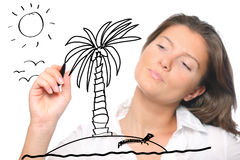 Young woman sketching her dreams. A young woman sketching her dreams of perfect holidays over white background Stock Images