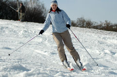 Young woman on ski. Young woman skiing royalty free stock photography