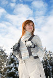 Young woman in ski dungarees Royalty Free Stock Images