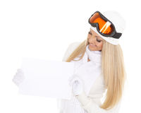 Young  woman in ski glasses with empty board for the text. Royalty Free Stock Photography