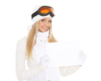 Young  woman in ski glasses with empty board for the text. Stock Photos