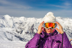 Young woman in ski goggles outdoors stock image