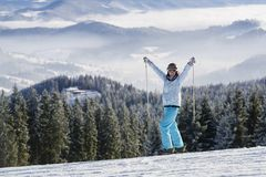 Happy female skier on a slope Royalty Free Stock Images