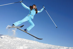 Young woman in ski suit Royalty Free Stock Image