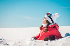 Young woman skier enjoying the snow sunbathing Stock Photography