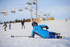 Young woman skier after the fall on mountain slope Stock Photography