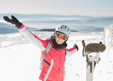 Young woman skier at ski resort in mountains Royalty Free Stock Image