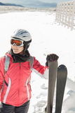 Young woman skier at ski resort in mountains Stock Photos