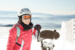 Young woman skier at ski resort in mountains Royalty Free Stock Images