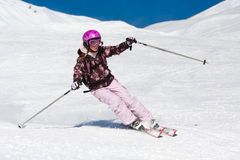 Young woman skiing Royalty Free Stock Photo