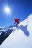 Young woman skiing. On the slopes stock photography