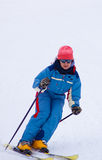 Young woman skiing fast Royalty Free Stock Image